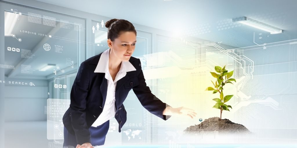 Woman activating technological portal displaying tree.
